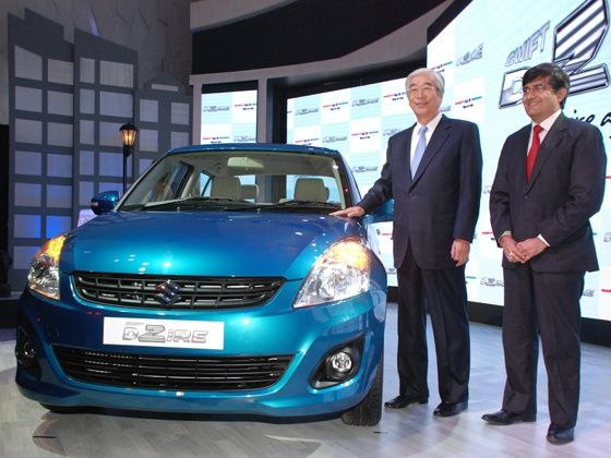 Maruti Suzuki unveils its new Swift DZire in Delhi. Seen with the car are Mr. S Nakanishi MD and Mr. Mayank Pareek MEO (Marketing and Sales)
