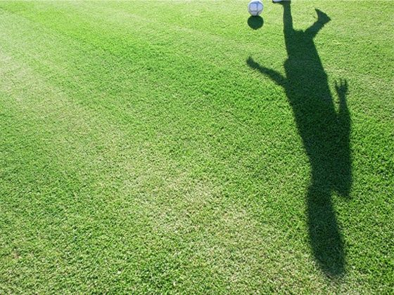 Shadow of footballer
