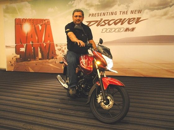 K.Srinivas poses with the Discover 100M at the launch