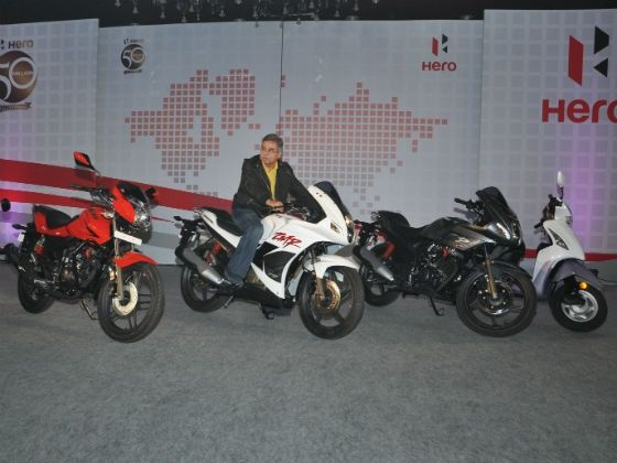 Pawan Munjal poses with the new range of bikes