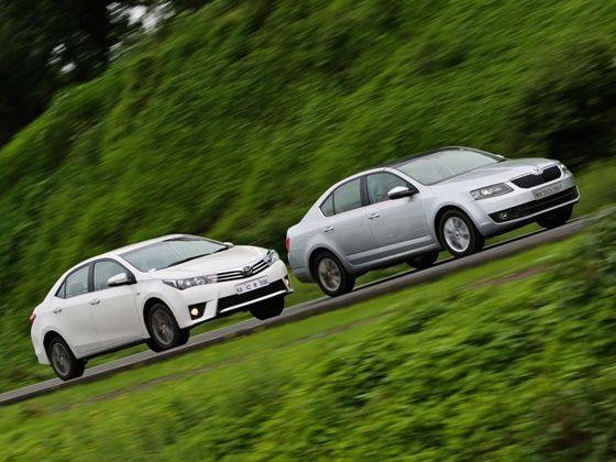 91971a264df559 Toyota Corolla Altis vs Skoda Octavia  Petrol Automatic Comparison ...