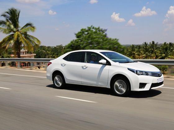 2014 Toyota Corolla Altis driving white petrol