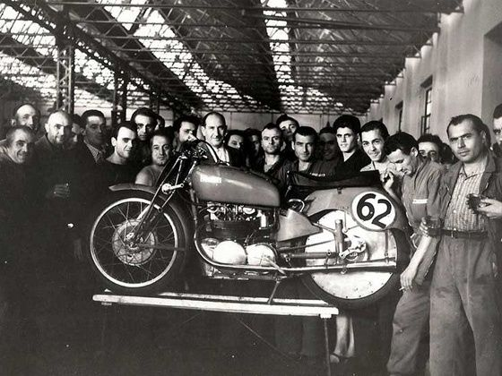 Old picture of Benelli engineers with a motorcycle at company workshop situated in Italy