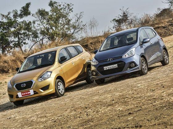 Datsun Go Plus vs Hyundai Grand i10 Petrol Comparison Review front