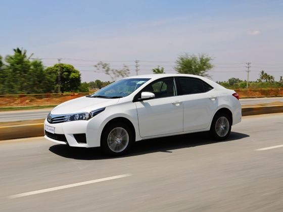 2015 Toyota Corolla Altis driving white sedan